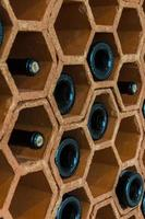 Wine rack with bottles photo