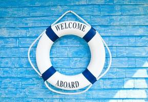 Life buoy with welcome aboard on it