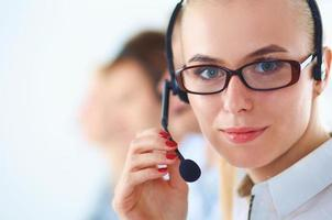 Attractive positive young businesspeople and colleagues in a call center photo