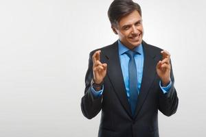 Portrait of happy businessman against white background