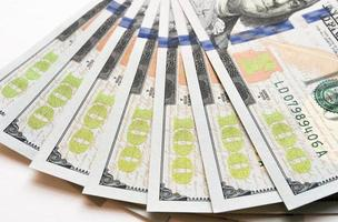 New US $100 Bills Fanned Out photo
