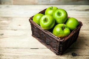 fruit. apples in a basket on wooden table photo