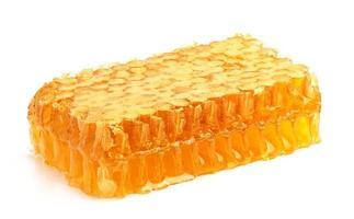 Miel fresca en el peine.