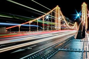 Chelsea Bridge at night in London with Bus Lights