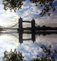 Famous Tower Bridge against sunrise London, England photo