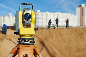 Surveyor equipment at construction site photo
