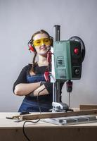 female carpenter and drilling machine. photo