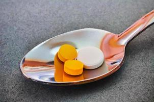 Teaspoon full of pills photo