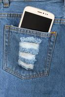 Smart phone in the pocket jeans. photo