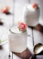 Rose flavor Greek yogurt in a glass jarwith lace