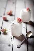 Rose flavor Greek yogurt in a glass jarwith lace photo