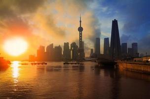 Shanghai Skyline rising sun viewed from the Bund