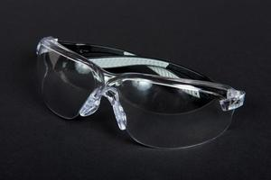 Protective glasses on black fabric
