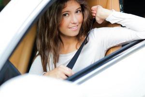Beautiful young woman driving her car photo