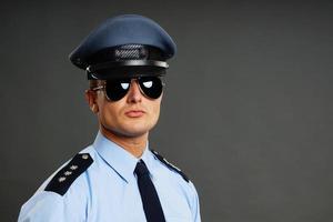 Portrait of policeman in uniform photo