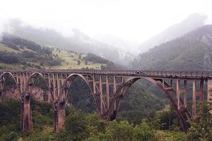bridge in the mountains fog clouds rain photo