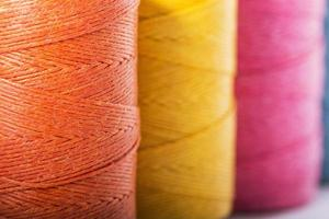 Thread Spools in yellow, orange and pink