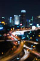 Blurred bokeh light nigh view of city road interchanged