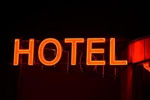 Neon sign of a small hotel.