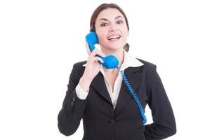 Woman or female contact person answering the phone smiling