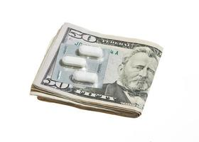 Dollar Currency and Pills photo