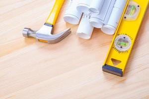 copyspace image white blueprints claw hammer construction level photo