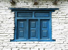 closed up the blue wood door with brick wall photo