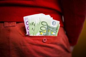 Euros in the red pants pocket