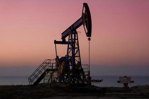 Oil derricks in sunset photo