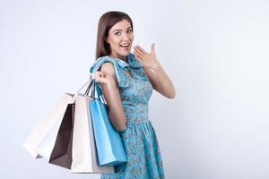 Cheerful young girl is purchasing a lot of clothing photo
