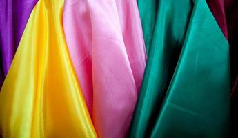 rolls of multicoloured textiles