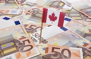 Flag of Canada sticking in 50 Euro banknotes.(series) photo