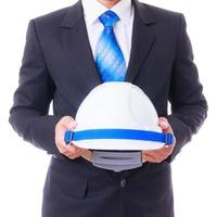 business man holding engineer helmet isoleted photo
