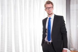 Portrait smart young man in suit and tie photo