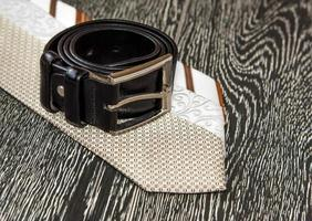 black leather belt and ties