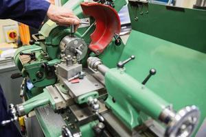 Engineering student using heavy machinery photo