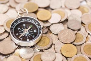 Close up Compass on coin stack photo