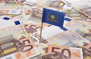 Flag of Pennsylvania sticking in 50 Euro banknotes.(series) photo