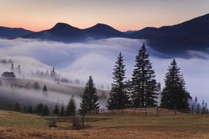 View of misty fog mountains in autumn,