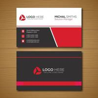 Business card with gray and red angled section vector