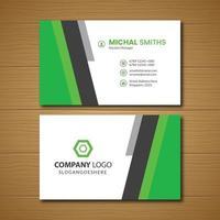 cartão de visita com formas de ângulo vertical verde e cinza vetor
