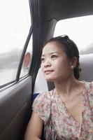 Young Woman Looking Out Window In Taxi