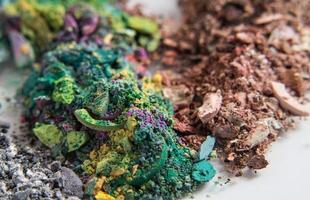 piles of eyeshadow crumbles in various colors photo