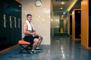 Sportsman in gym checkroom photo
