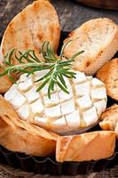 Baked Camembert cheese with rosemary