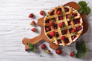 homemade strawberry pie horizontal top view, rustic style photo