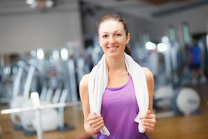 Portrait of young woman in a gym