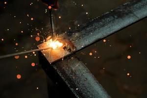 worker with welding metal