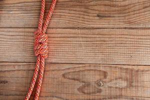 Junction between two mountain ropes on wooden background