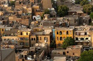 Slum Cairo roofs with satellite dishes.